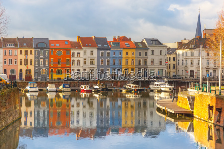 river leie colored houses and belfry