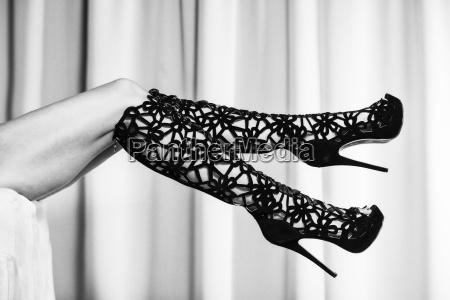 woman in black ornate high heels