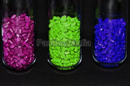 3 colored plastic granules in front