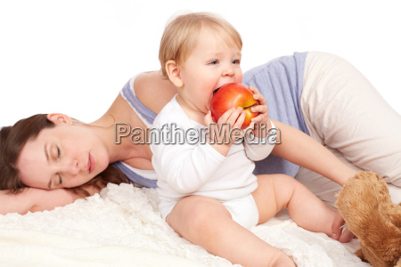 mother is asleep and child eats
