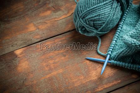 woollen thread and knitting needle