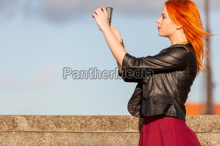 woman taking photo with camera picture