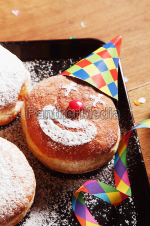 sugared donuts with clown face and