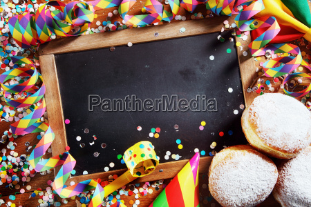 black board with donuts and carnival