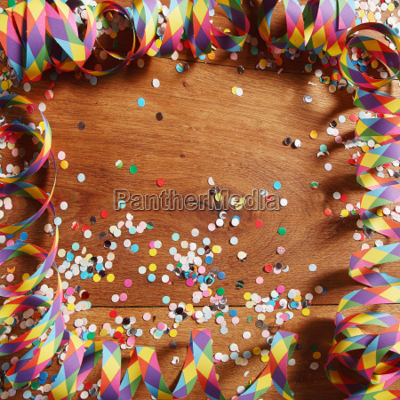 colorful carnival frame of streamers and