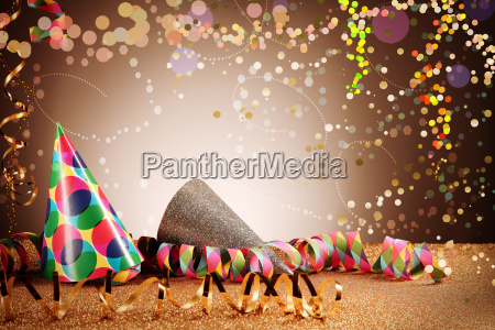 party cone hats and streamers with