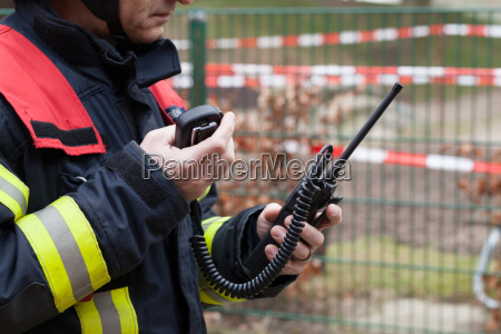 firefighter with radio in action