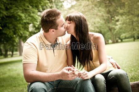 intimate moments couple kissing outdoors