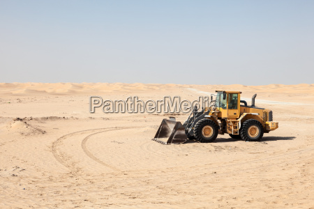compact wheel loader in the desert
