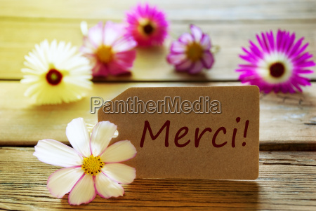 sunny label with french text merci