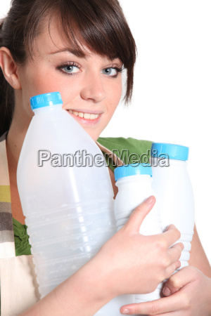 woman with empty plastic bottles