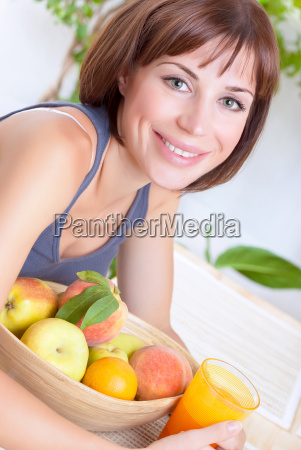 cute female eating fruits