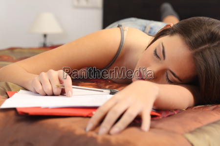 student tired and sleeping in her
