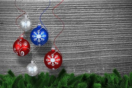 composite bild von digital haengende weihnachtskugel