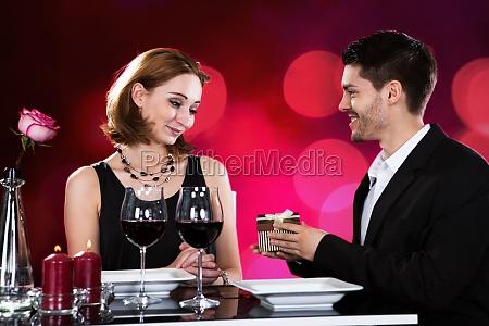 portrait of happy couple holding gift