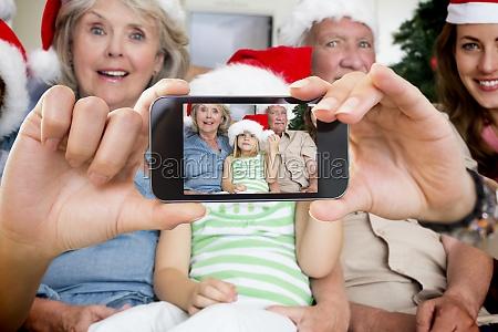 composite bild von hand holding smartphone
