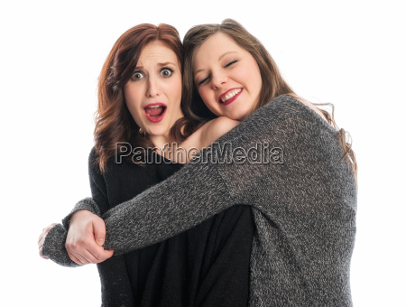 girl is embraced by friend and