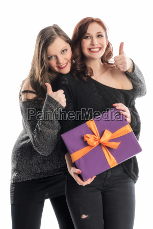 2 girl with gift showing thumbs