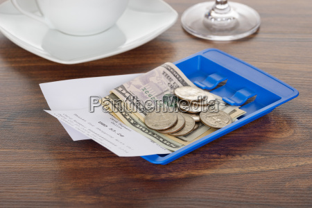 bill and currency on table