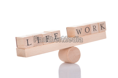 seesaw representing imbalance between life and
