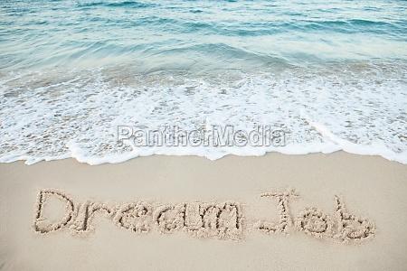 wort flitterwochen geschrieben am strand