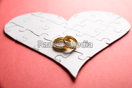 rings on heart made of puzzle