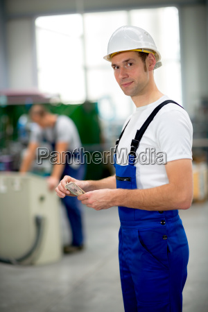 worker with his wages