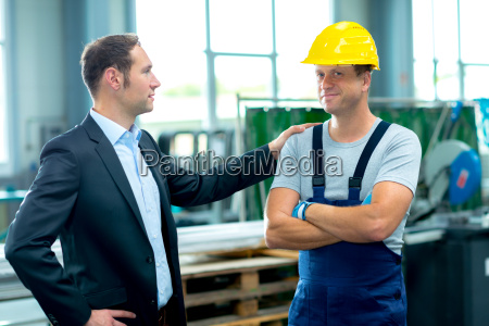 young boss and worker in factory