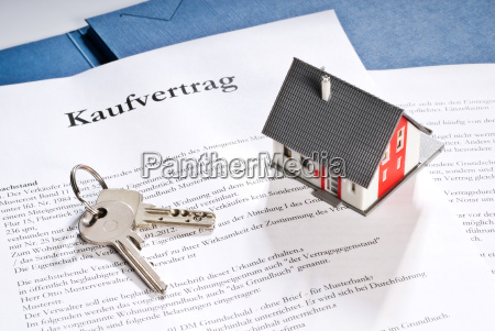 house with key and purchase contract