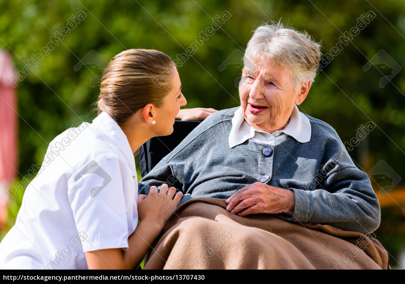 nurse, holding, hands, with, senior, woman - 13707430