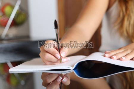 woman writer hand writing in a