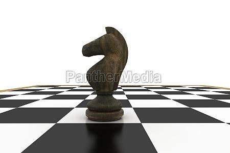 schwarzer ritter auf schachbrett
