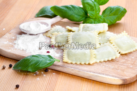 homemade pasta ravioli with fresh basil