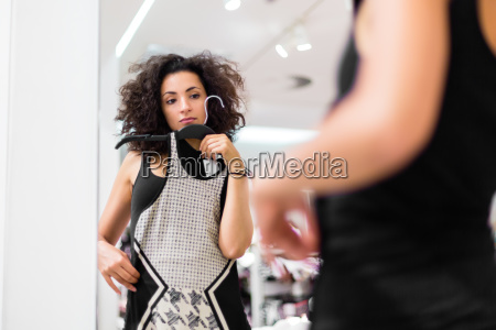 woman at window shopping in the
