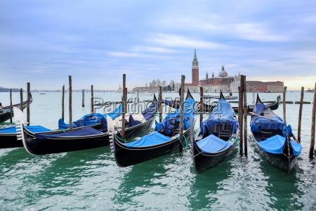 gondolas moored in front of san