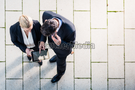 man and woman working outside top