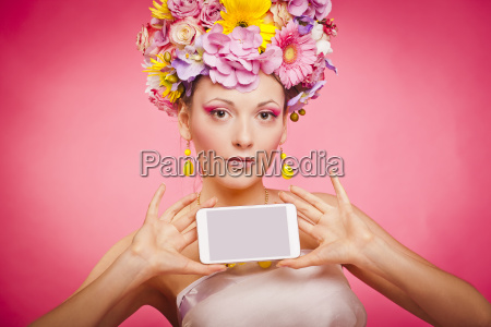 spring flowers girl is holding smartphone