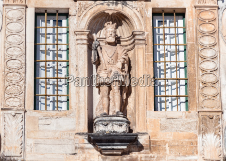 sculpture on the entrance to coimbra