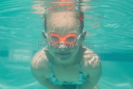 cute kid posing underwater in pool