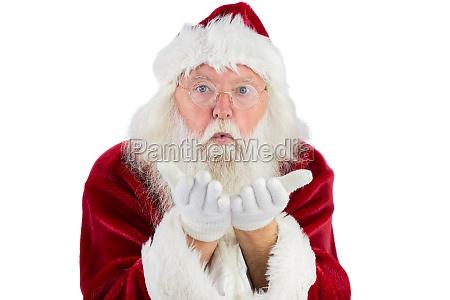 der weihnachtsmann blaest etwas in deine