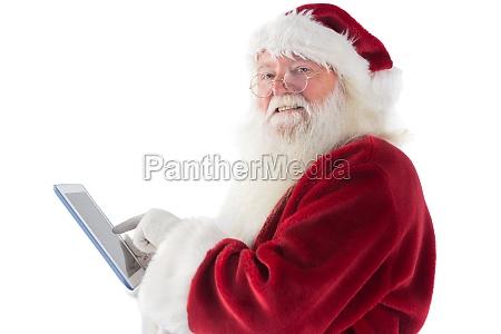 der weihnachtsmann benutzt einen tablet pc