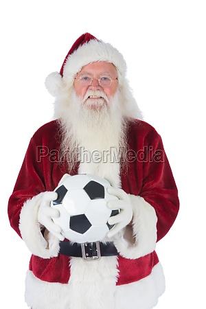 santa haelt einen klassischen fussball