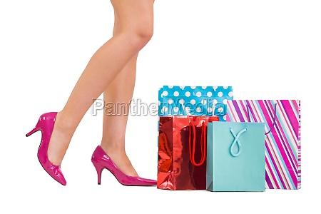 womans beine in high heels mit