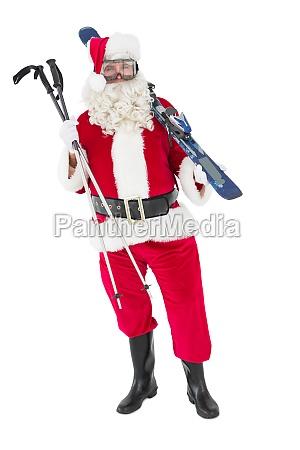 weihnachtsmann der ski und skistoecke