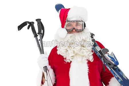 gluecklicher sankt posiert mit ski und