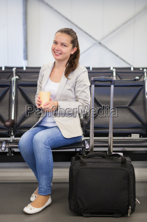 businesswoman having coffee at airport lobby