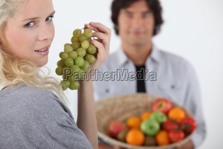 couple stood with fruit basket
