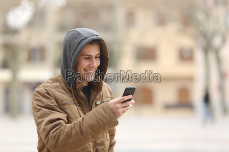 happy teen walking and using a