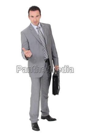 businessman beckoning in a studio