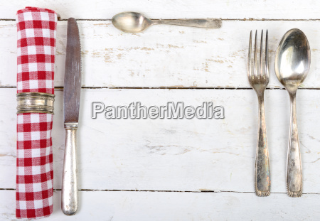 silver cutlery with red towel on